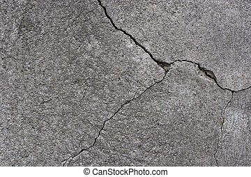 cracks in the plaster of a wall