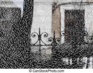Cracks in the window glass. Texture broken glass