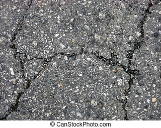 Cracks on asphalt background