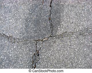Cracks on asphalt background