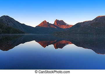 Cradle Mountain landscape perfectly reflected in lake Dove...