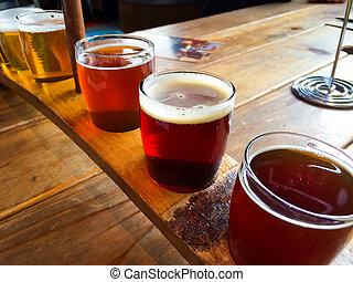Craft Beer Sampler - Craft beers are served together in a...
