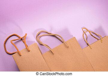 Craft cardboard bags on violet background - Craft cardboard ...