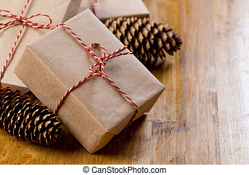 craft christmas presents on wooden background.