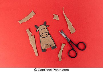 craft cow made of cardboard, craft for small children for a holiday, activity with parents, Paper art character bull cow craft for kids, Animal cardboard figurine, Children play home. Ox year.