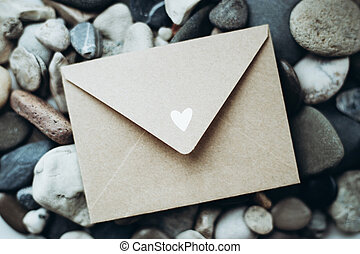 Craft envelope with a heart on sea stones - Craft envelope ...
