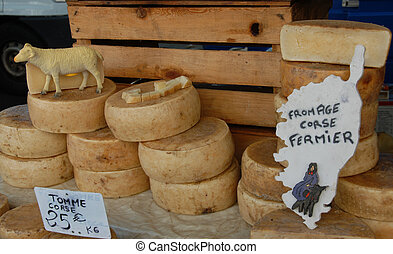 ewe's cheeses - craft ewe's cheeses in a market in corsica