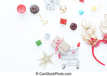 Craft gift box in shopping cart and Christmas gift boxes and decorations on white background