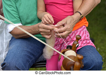 Craft lesson for young people - Old lady teaches her little...