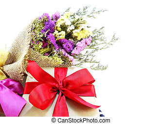 craft paper gift box with ribbon bow and flower bouquet