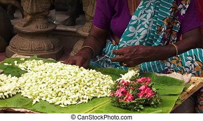 Crafting a cultural floral braid in India - A medium static...