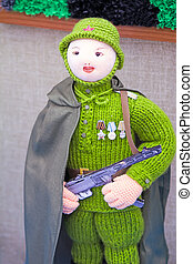 Crafts: crochet figurine of a female soldier.