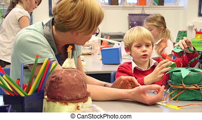 Crafts In The Classroom - Teacher is sitting in the...