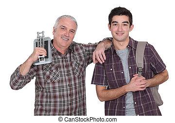 craftsman and apprentice posing