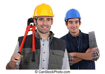 craftsman and apprentice posing together