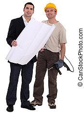 craftsman and businessman examining a blueprint