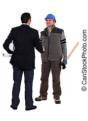 craftsman and businessman shaking hands