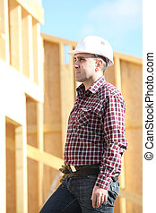 craftsman building a wooden house