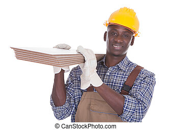 Craftsman Carrying Floor Tiles - Young Happy Craftsman...