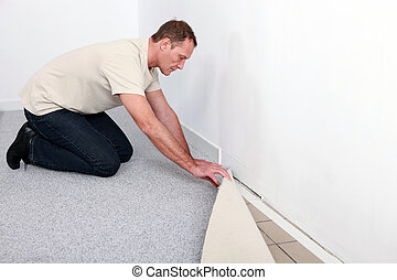 craftsman fitting a carpet