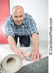 craftsman fitting carpet on floor