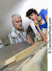 Craftsman giving instructions to his apprentice