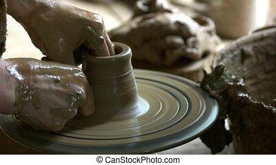 Craftsman hands making pottery bowl. Hands of potter making ...