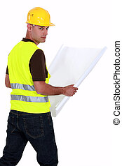 craftsman holding a blueprint