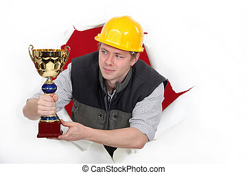 craftsman holding a golden cup