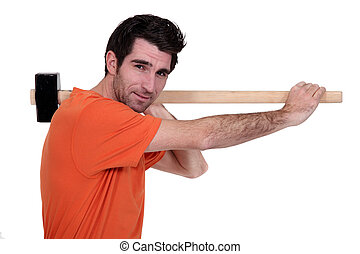 craftsman holding a hammer on his shoulder