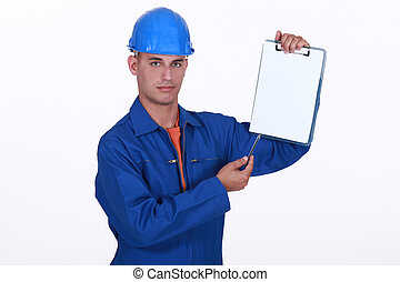 craftsman holding a notepad