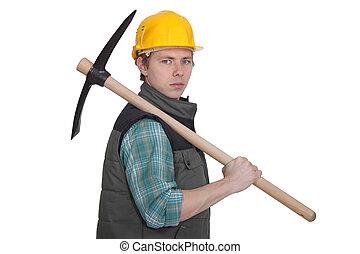 craftsman holding a pickax