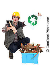 craftsman holding a recycling label and pointing at a box of used materials