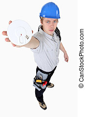 craftsman holding a sensor device