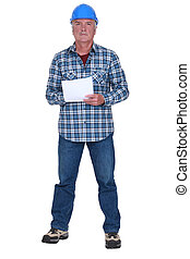 craftsman holding a sheet of paper