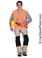 craftsman holding a spanner