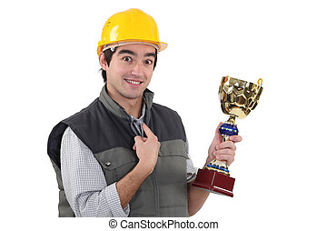 craftsman holding a trophy
