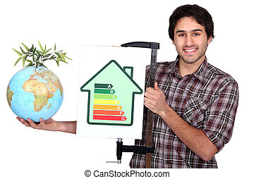 craftsman holding an energy consumption label and a globe with green plant on it