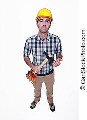 craftsman holding hammer looking threatening