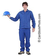 craftsman holding his helmet