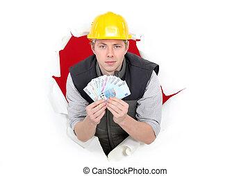 craftsman holding money