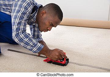 Craftsman Installing Carpet On Floor
