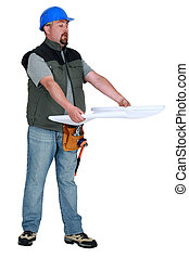 craftsman looking at a blueprint