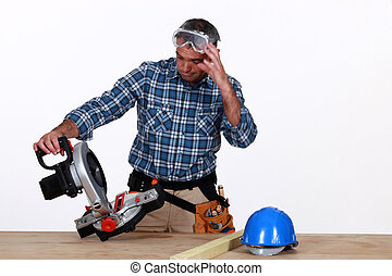 craftsman looking at his new electric saw