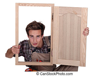 craftsman looking through a window frame
