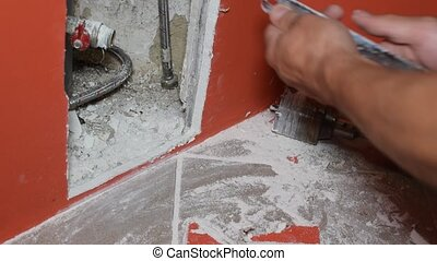 Craftsman makes an inspection opening in plasterboard wall...