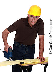 craftsman making holes in a board with a drill