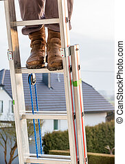 craftsman on a ladder at home