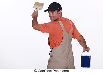 craftsman painter holding a brush and a can