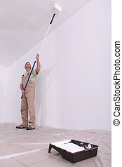 craftsman painting a ceiling